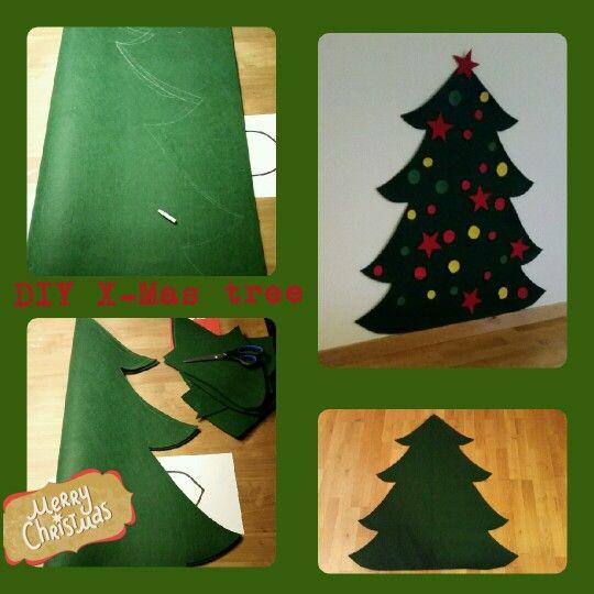 DIY x-mas tree for kids / kerstboom van vilt! Leuke speelboom waar je kinderen de vilten kerstballen en sterren eenvoudig kunnen verplaatsen!  Speel ze!
