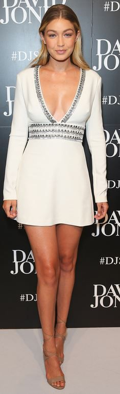 Gigi Hadid's wearing  Dress – Christopher Esber  Shoes – Guess