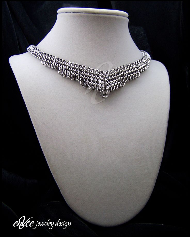 "Art-Deco stainless steel necklace...  496 individual stainless steel rings woven in a tight sheet weave (Half-Persian 3-1, Sheet 6), mirrored, and joined in the middle with a graduated ""Persian Teardrop"". Adjustable from 16-17"", weighs just over 2 ounces"