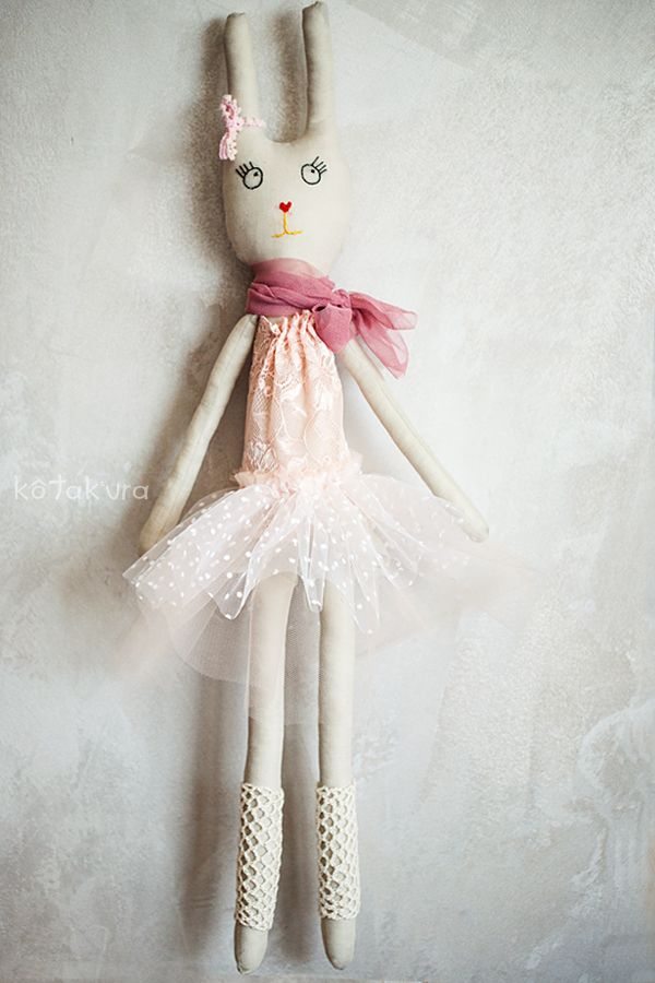 Salma - handmade Bunny Ballerina. She loves asparagus and ballet lessons. She wears tutu skirt and lace shirt all in delicate shades of pink, salmon and white. She has hand embroided face and crochet legwarmers. Height: approx 65 cm.