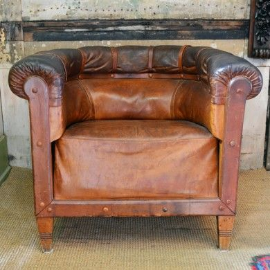 A 1920's French leather horseshoe armchair