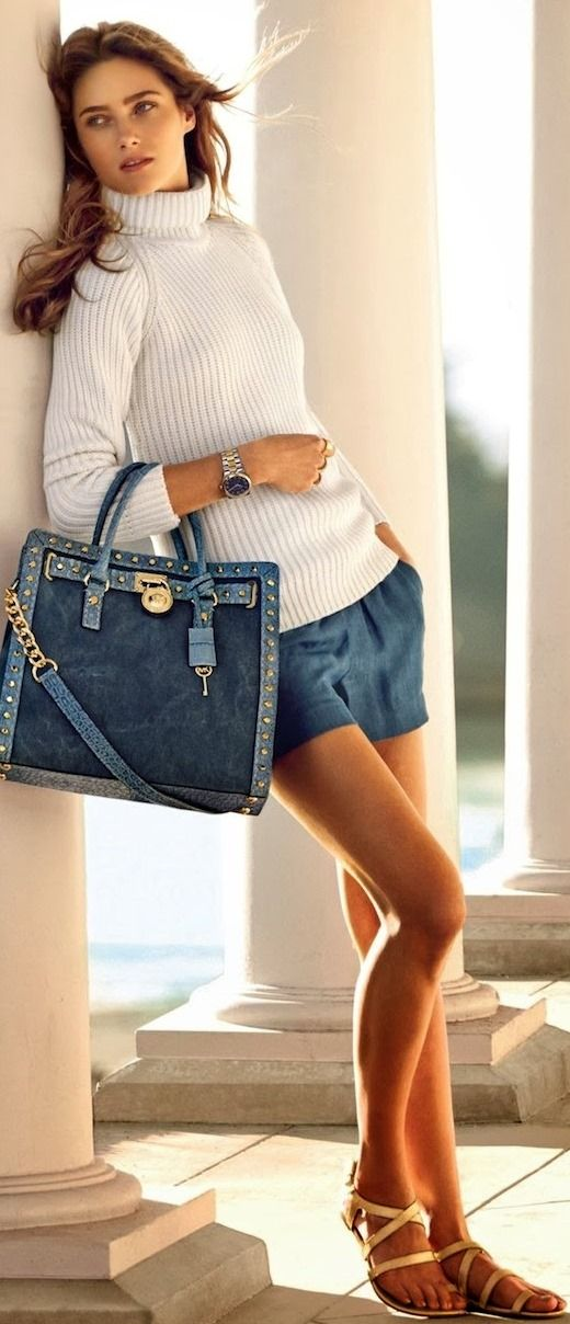 high neck sweater with mini skirt with hand bag