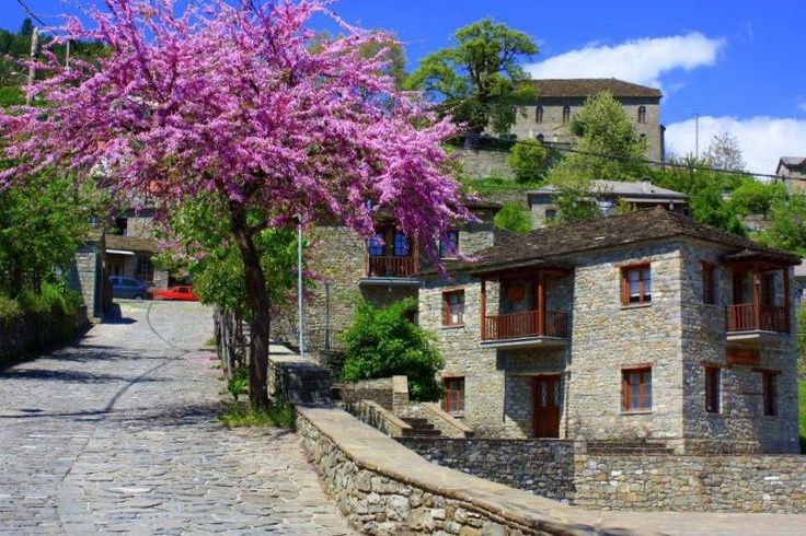 Beautiful colors of the blooming almond tree in the village Pyrsogianni of Ioannina. Deserve to walk on the cobbled paths and admire the old houses, many of which were built in the 17th century ... the stone fountains ... the doors with the slate ... and all other creations of architecture that flourished in this place. From there came some of the most famous craftsmen!!!