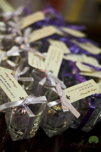 Wedding favors: Shot glasses with hershey's kisses in them.