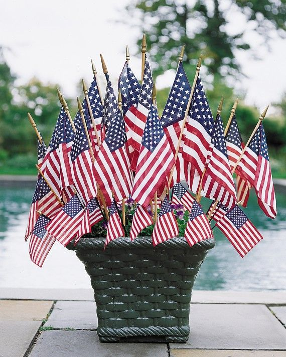 Small flags of graduated sizes burst from a basket-weave planter in front of Martha's pool.