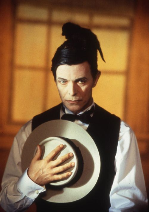 David Bowie impersonates Buster Keaton with a cat on the set of Miracle Goodnight video, 1993. Photo by Jeffrey Mayer.