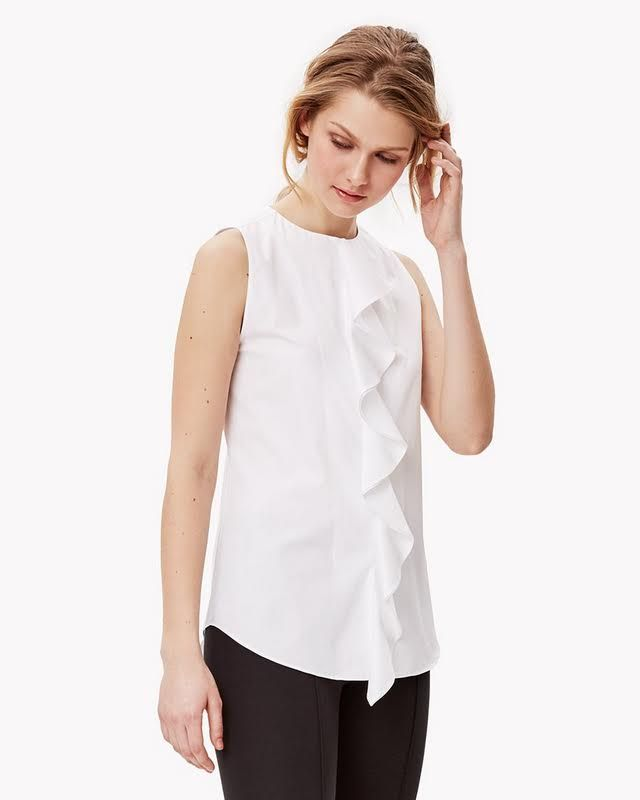 The ruffle-front shirt. With its rounded collar and ultra-feminine center ruffle front, this cotton essential makes a romantic statement on its own and as an underpinning for any suit. Pair it with any cotton bottom or crop pant for the look of spring.