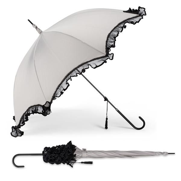 A purely feminine stick umbrella adorned with sheer ruffled frill. Features easy, automatic opening and a black tassel accent.