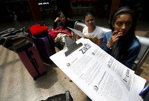 2/1/2016 COLOMBIA: Travellers are given information on how to prevent the spread of the Zika virus at the main bus terminal in Bogotá, Colombia