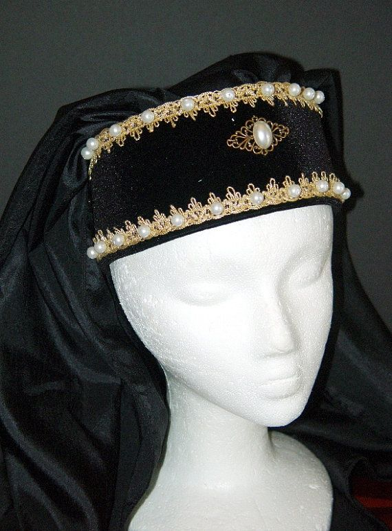 This hand-crafted, professionally made headpiece was created based on the headdresses worn by royalty and the landed gentry of the Medieval and Renaissance Eras. It will add that finishing touch to any noblewomans attire. Winning Bidder can choose their choice of pearl color (white or cream) and cabochon colors from the chart below the pictures! The use of Hoods in general had been used in England for years - This headpiece is a perfect compliment to any dress. This is another of my…