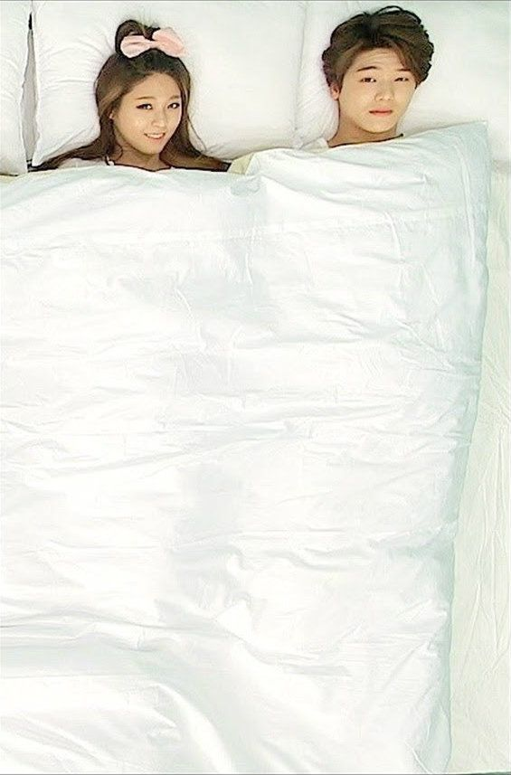 """CNBLUE's Minhyuk and AOA's Seolhyun Share a Bed in """"Brave Family"""" Photo"""
