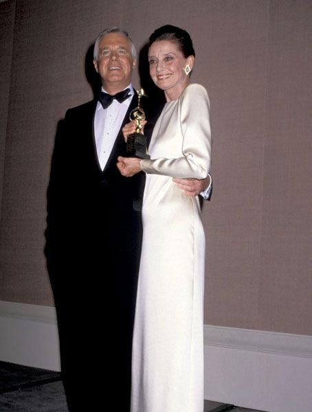 Audrey Hepburn poses with her Breakfast at Tiffany's costar George Peppard at the 47th Annual Golden Globe Awards holding her Cecil B. Demille award.