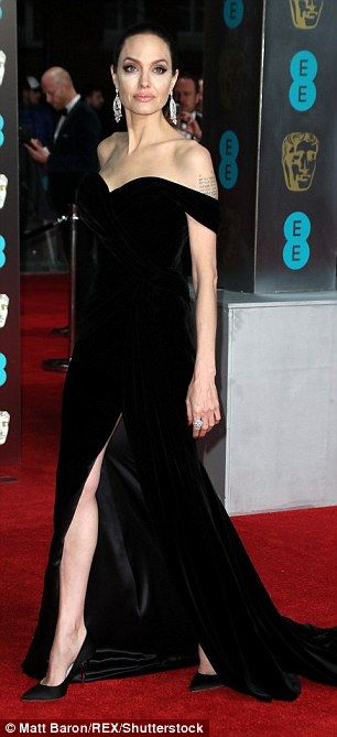 Glam: The raven-haired beauty's one shouldered number featured a daring thigh-high slit wh...