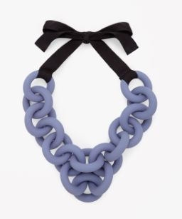 With a grosgrain ribbon tie fastening, this necklace has chunky interlocking rings in brightly coloured rubber.