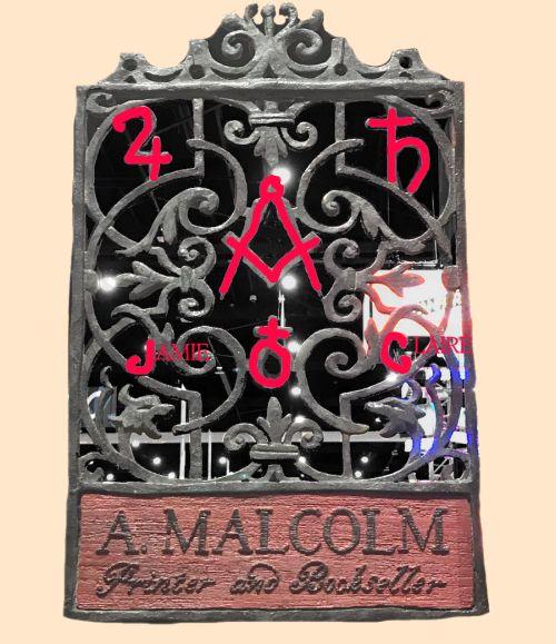 Symbols in the A Malcom Printer sign