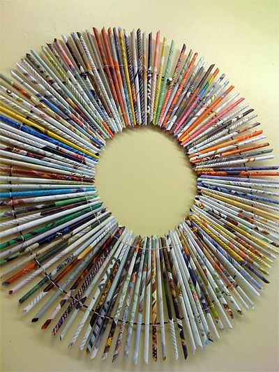 Recycle magazine pages: roll them into reeds (thin tubes), and voila... you have a sunburst frame in the making!