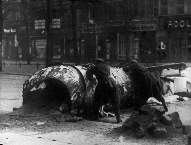 Socialist revolutionaries man a Berlin barricade during the short lived Spartacist Uprising in January, 1919. They were quickly crushed by the Freikorps with the blessing of the Provisional...