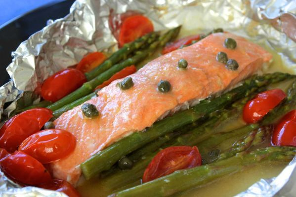 A brilliant, easy dinner is poached salmon with asparagus. Simply wrap up the fish and veg and pop in the oven! It's very low fat and high in nutrients like omega-3 fatty acids.