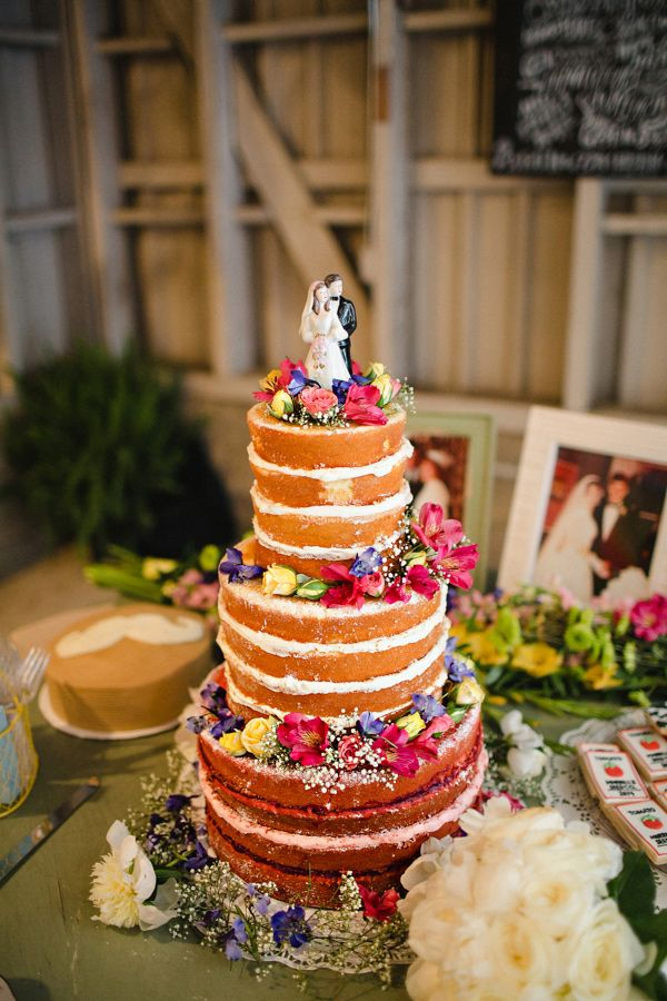 naked wedding cake topped with flowers, photo by Kelly Ginn Photography http://ruffledblog.com/memphis-farmers-market-wedding #weddingcake #cakes