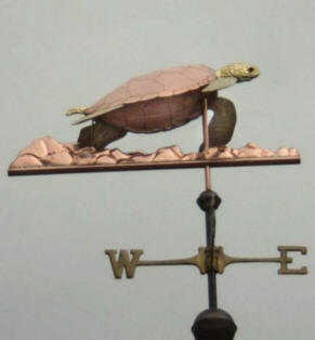 Sea Turtle & Coral Weather Vane by West Coast Weather Vanes.  This custom made handcrafted Sea Turtle weathervane has a copper shell with brass head, flippers and tail. and a copper coral sea floor.