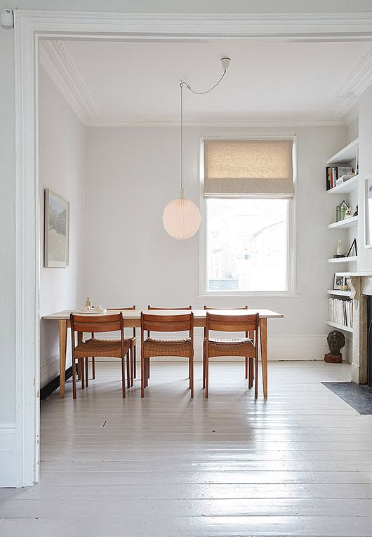 White dining room with wooden chairs love the contrast