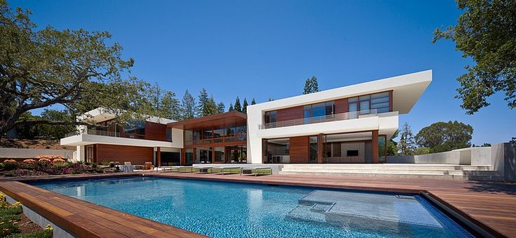 OZ Residence by Swatt | Miers Architects...nice use of angles, wood and glass.