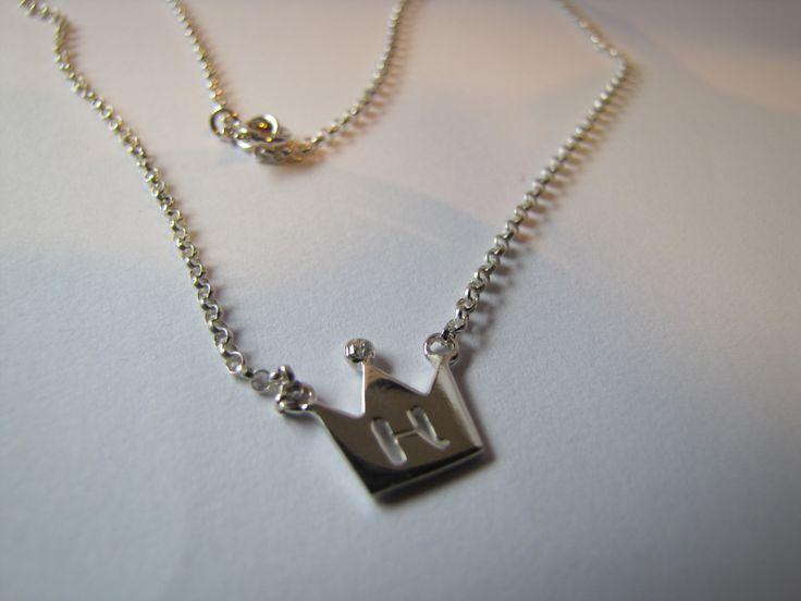 Cute silver pendant with diamond