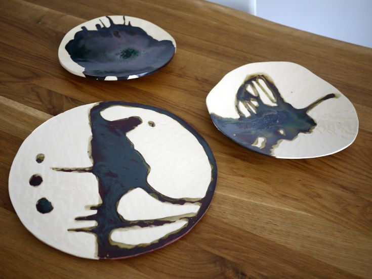 Series of different ceramic plates in monochrome style. A little bit of copper, black and brown in it. For someone who is looking for a handmade gift, that is one and only.