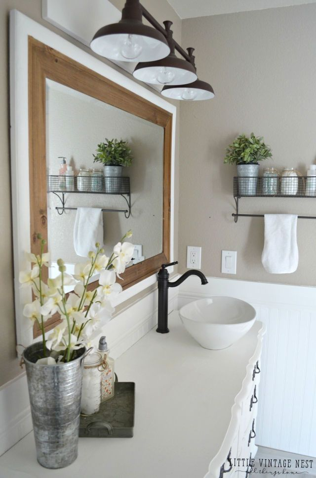 Most towel racks come with a single bar to hang towels from, but the ones this blogger used throughout the space have additional storage above the rack.
