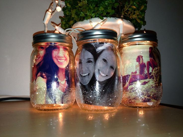 My Christmas gift to my best friend. Really simple. I used blank mason jars, painted the bottom with glossy Mod Podge and dusted them with glitter. I then used my Instagram prints from www.foxgram.com (4X4) and slid them into the jar. Voilá. (It was her idea to feed her twinkle lights into the jars to light the photos from behind. Doubles as a great night light!)