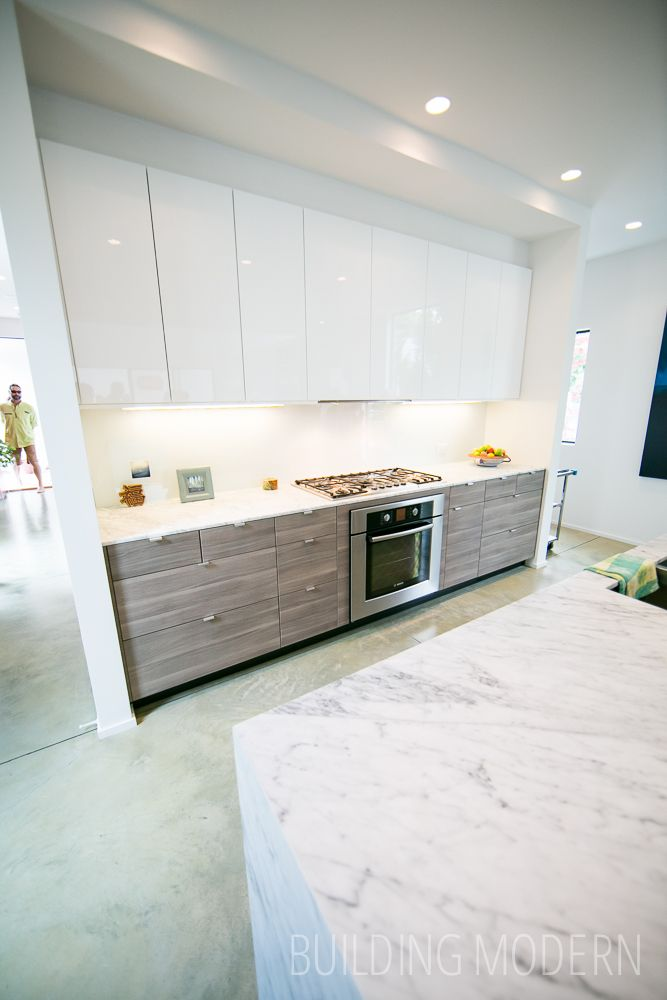 184 Pearl Street on the Modern Atlanta Home Tour. 2,150 sq. ft. / 3 bed, 3 bath. Brian Ahern and Jeff Darby of Darby Construction. Ikea Sofielund walnut effect and Abstrakt high gloss white Kitchen. Green stained concrete floors, marble island countertop.