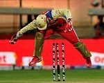 RCB wicket keeper A.B. DeVilliers jumps over the wicket in a match in DLF IPL 2012 in India.