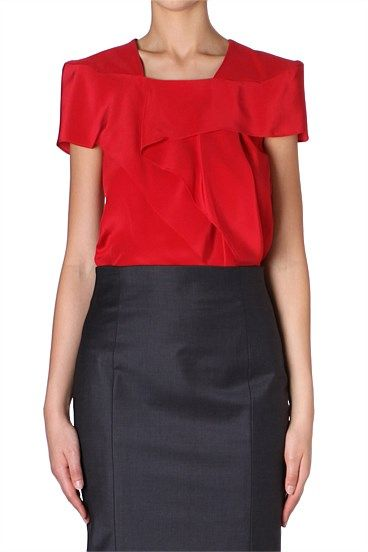 ROUGE SILK CDC PETAL TOP A striking silhouette is crafted from rouge silk and ruffle detailing. An easy option that can take you from day to night with ease, wear with our charcoal curve skirt to complete the look.