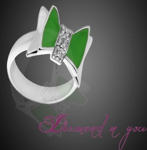 This green shaded ring is designed with diamonds in the centre to make others envy you! Crafted with the most delicate combination of style and subtleness, this is what you were looking for your daily use.    Get a FREE Diamond Pendant with this Ring!!!    You can buy it here - Diamondnyou.com