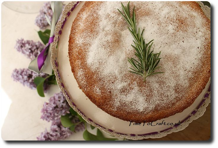 victoria sponge with rosemary and lilac. Make a centre piece at a party with a glass dome cake stand