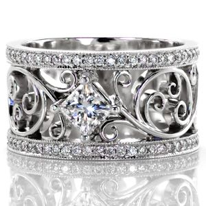 A beautiful vintage inspired ring. Lauren from Knox Jewelers contains a fluid curl pattern that embraces the center princess cut diamond. The design is framed with micro pave diamonds that compliment the piece. #filigree #princesscut