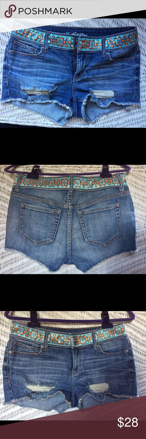 """VS Embellished Hipster Short Shorts Adorable  factory destroyed Jean Cutoff Shorts .  Satiny aqua, orange, and green geometric ribbon embellishment around waist. Size 4. Waist measured flat is 15.5"""", 8.5"""" rise, 2"""" inseam. These are NWOT, never worn.  99% cotton, 1 % elastane. Shorts are soft and have some stretch. Waistband doesn't stretch due to embellishment. Victoria's Secret Shorts Jean Shorts"""