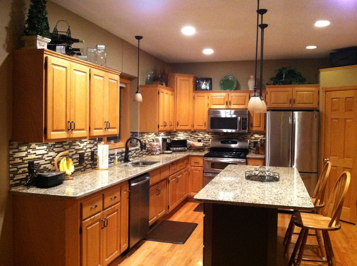 After Photo Santa Cecilia Granite Countertops Oil Rubbed Bronze Hardware And Faucet Delta