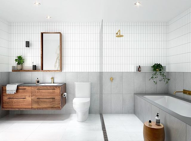Love the combo of large format tiles below, and vertically stacked subway tiles above.