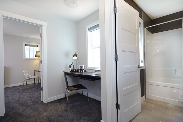 Handy desk area adjacent to the second floor bedrooms in the Tofino II showhome in Hillcrest in Airdrie by Shane Homes.