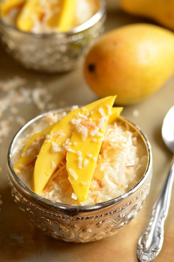 Mango Sticky Rice -      14-oz can coconut milk     1 cup sweetened condensed milk     1 cup sweetened shredded coconut, divided     4 cups cooked Jasmine rice     3 ripe mangoes