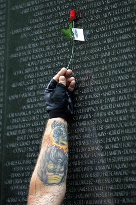Never to be forgotten.....Dave Wetiner holds a rose over the name of his friend, Alfred F. Hall, at the Vietnam Veterans Memorial. Motorcyclists have been coming to Washington since 1988 for the traditional annual Rolling Thunder events during the Memorial Day weekend.
