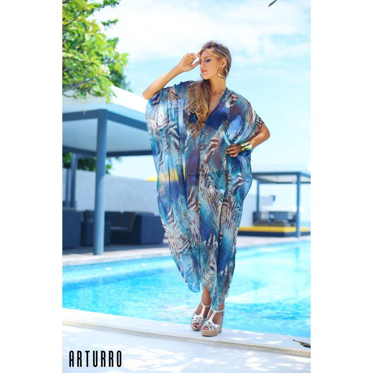 ARTURRO Resort Collection-Turquoise Zebra Printed Kaftan Available at ARTURRO Boutique Jl. Kayu Aya no 18 Oberoi & Made's Warung Seminyak Bali Indonesia, #arturroeggo #resortwear #womansfashion #resort #beach #beachwear #kaftan # caftan #printedkaftan #smartcasual #elegant #sexy, FB Page : arturro