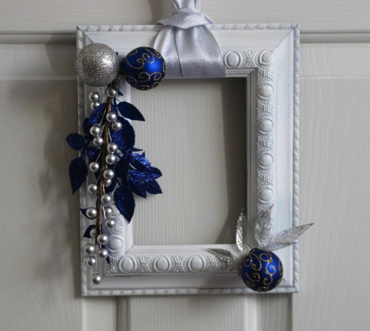 Picture Frame Christmas Wreath - White, Silver and Deep Blue. $20.00, via Etsy. At: www.badcandystudios.etsy.com.