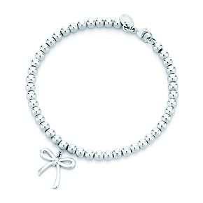 Tiffany & Co. | Item | Small bow in sterling silver on a bead bracelet, medium. | United States