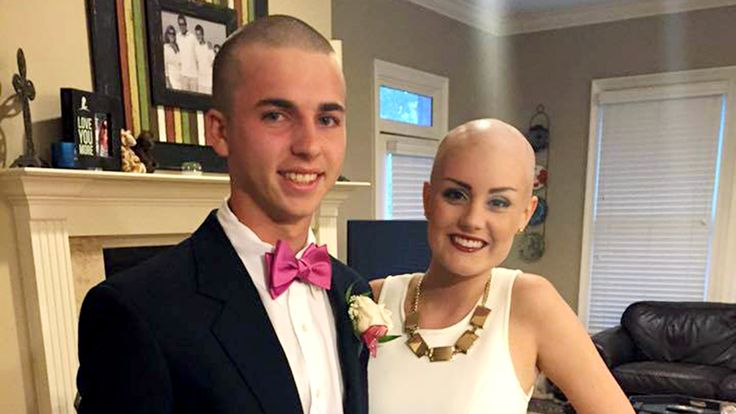 Teen surprises homecoming date battling cancer by shaving his head