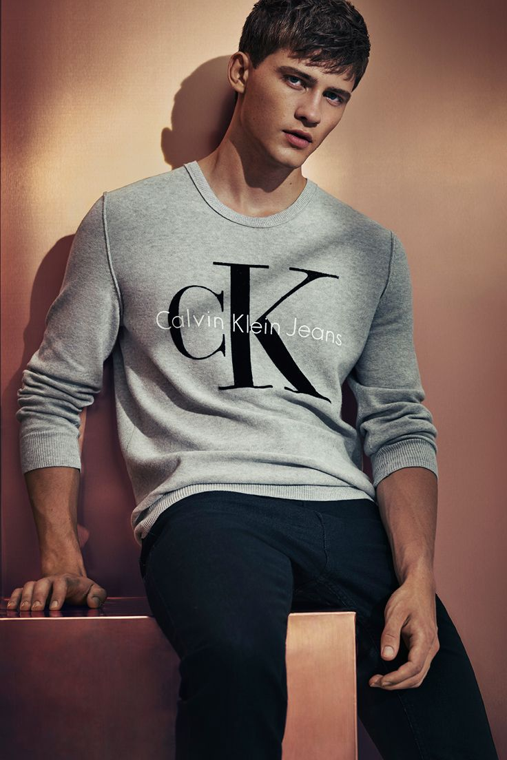 Spend the holidays in #mycalvins with the classic logo v-neck sweater from Calvin Klein Jeans.
