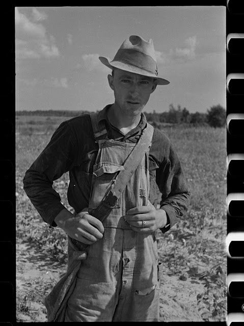 George because he's smaller a b d a bit younger looking. He's said to be a little smaller and could picture him wear the classic workers overalls With a field he was probably working on behind him.