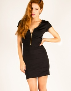 Mini bodycon dress with zipper on the chest and open back.