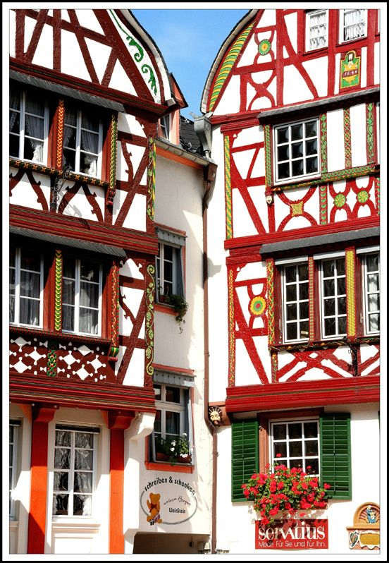 Bernkastel-Kues is a charming village located along the Mosel river, Germany: houses with half-timberings, flowers, roots of slates, grapevines which stop at the village's entrance.